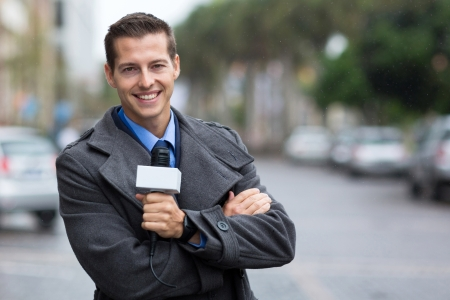 happy professional news reporter portrait in the city in the rain