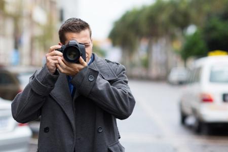 professional journalist taking photos outdoors photo