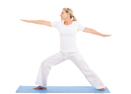 healthy middle aged woman practicing yoga exercise on white background photo