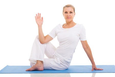 beautiful middle aged woman: beautiful middle aged woman yoga pose on white