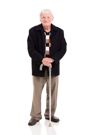 happy elderly man with his walking stick on white background photo