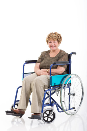 beautiful senior woman sitting on wheelchair isolated on white background