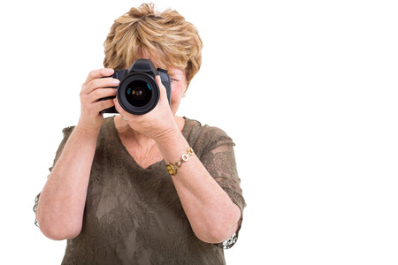 senior female amateur photographer taking photos isolated on white photo