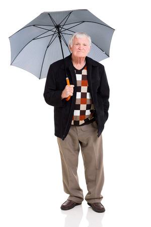 senior man standing under an umbrella on white background photo