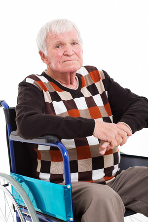 close up portrait of disabled senior man sitting on wheel chair on white background photo