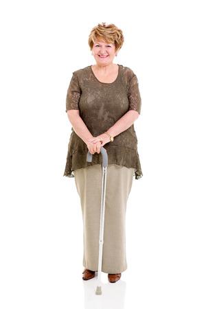 walking stick: beautiful senior woman with walking stick on white background Stock Photo