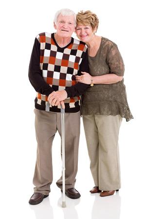 walking stick: lovely senior couple isolated on white background