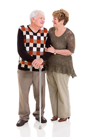 cutout old people: loving senior couple talking to each other isolated on white