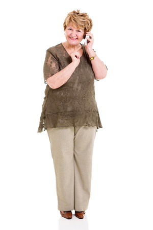 happy retired elderly woman talking on her mobile phone photo