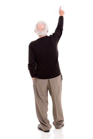 rear view of old man pointing at copy space isolated on white