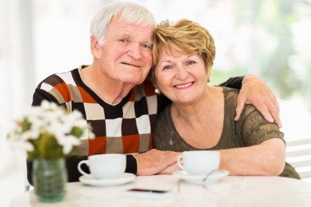 portrait of loving senior couple relaxing at home photo