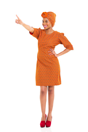beautiful african woman pointing copy space on white background photo