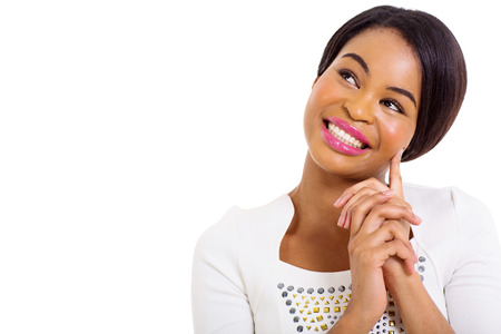 thoughtful african american woman smiling on white background photo