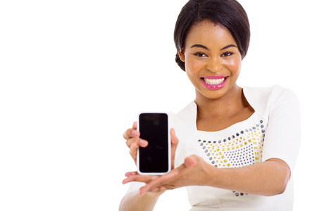 young african american woman presenting smart phone over white background photo
