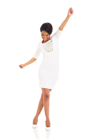 young african woman dancing on white background photo