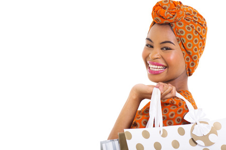 close up portrait of young african woman holding shopping bags isolated on white