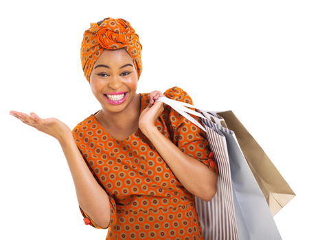 beautiful african woman in traditional clothes carrying shopping bags on white background