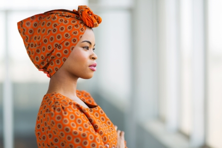 traditional dress: fashionable african businesswoman wearing traditional clothes in office