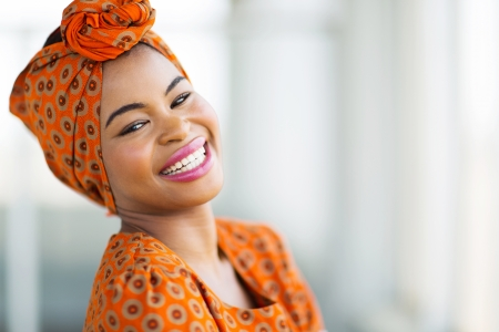 happy african woman wearing traditional attire
