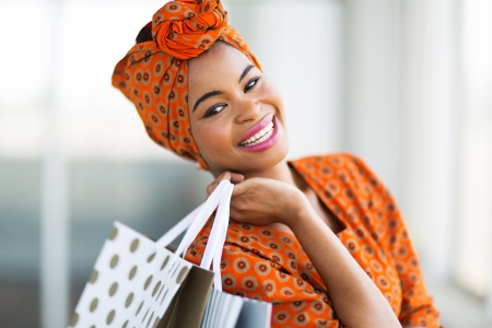 happy attractive african shopper in shopping mall 写真素材
