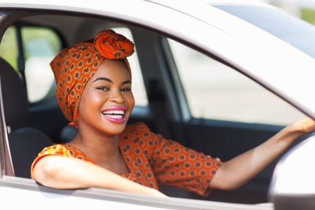 attractive young african woman in a car photo