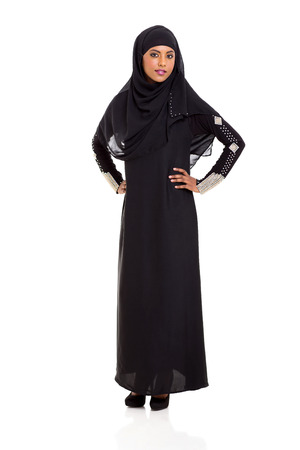 middle eastern clothes: attractive young muslim woman standing