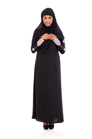 islamic prayer: beautiful young arabic woman praying