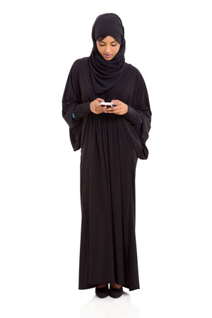modern islamic woman using smart phone isolated on white photo