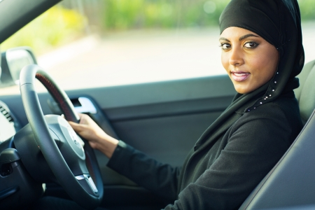 woman driving car: beautiful modern muslim woman in a car