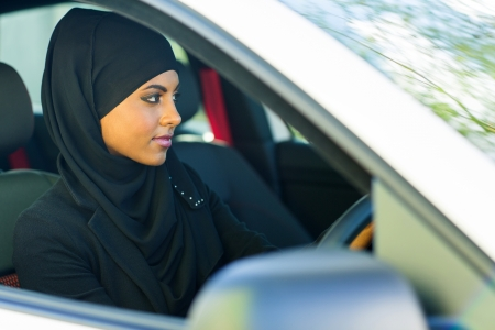 woman driving car: attractive young muslim woman driving a car