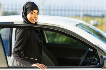 muslim girl: attractive arabian girl getting in a car