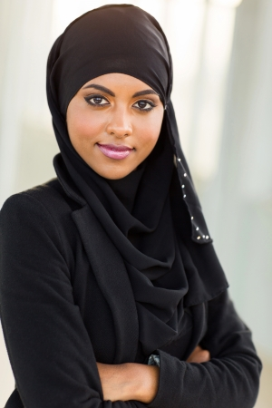 business costume: pretty young muslim businesswoman with arms crossed