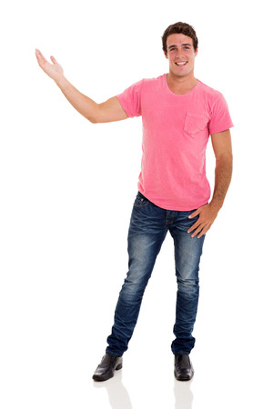 man in jeans: cheerful young man presenting isolated on white background