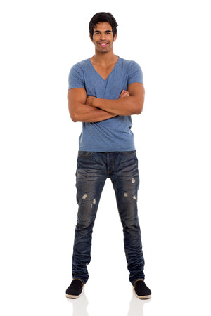 portrait of indian guy with arms crossed isolated on white photo