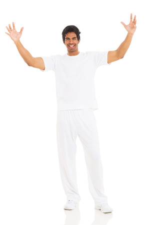 happy young indian man with arms up on white background