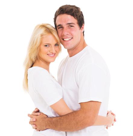 happy couple white background: portrait of happy couple hugging over white background