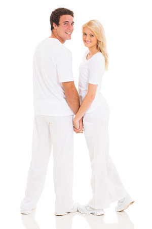 lovely couple holding hands on white background photo