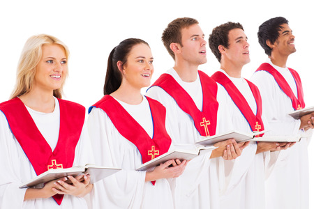 church choir members holding hymn books and singing photo