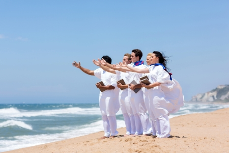 young church choir singing on the beach photo