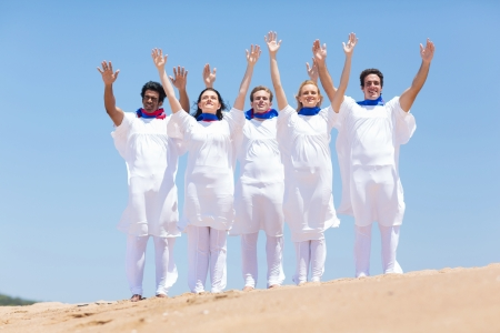 group of Christian church choir praising and worshiping outdoors photo