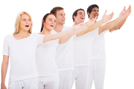 group of young singers performing on white background Stock Photo