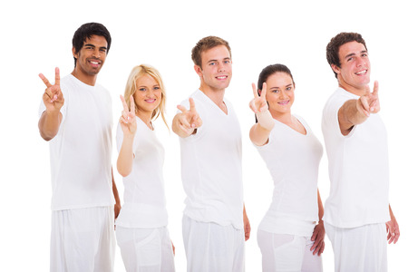 group of smiling friends showing peace hand sign on white background photo