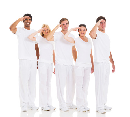 Salute: group of friends making salute gesture on white background