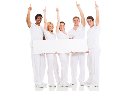 group of smiling people with blank white board and pointing up photo
