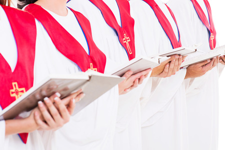 close up portrait of church choir holding hymn books photo