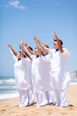 church group: young church choir worshiping on the beach Stock Photo