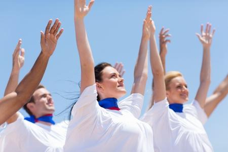 group of Christian church choir praising and worshiping outdoors