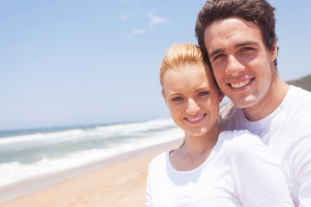 portrait of happy couple at the beach photo