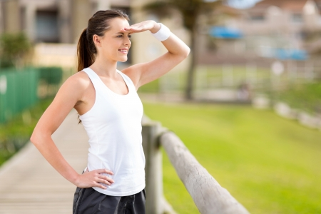 beautiful young exercise woman outdoors and looking into distance photo