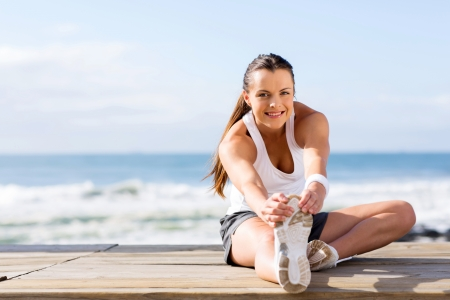 stretching: healthy woman stretching before fitness exercise Stock Photo